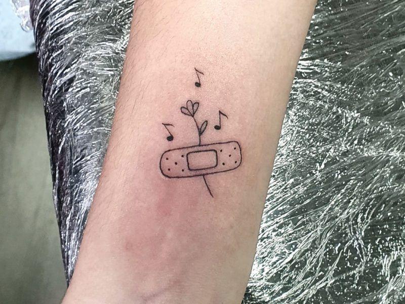 tatuaje simbolo covit